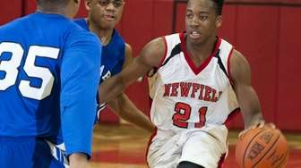 Newfield's Jarrel Cowell tries to get around North