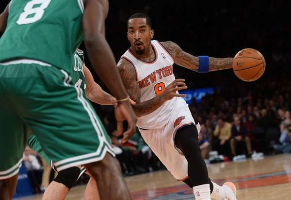 J.R. Smith drives the ball past Celtics Jeff