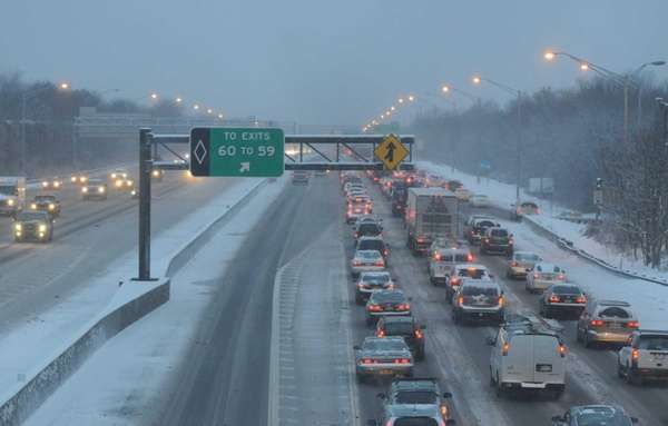 Snowy roadways along the westbound LIE between exits