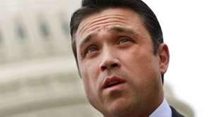 Rep. Michael Grimm speaks on Capitol Hill in