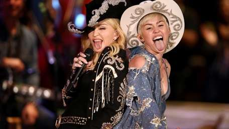 Madonna and Miley Cyrus perform during