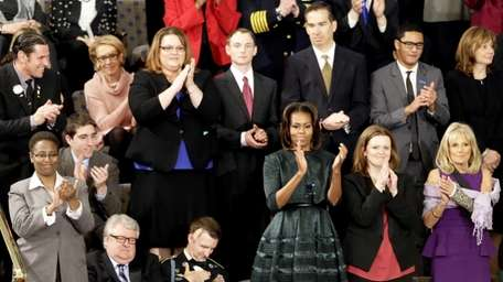 Among those sitting with the first lady Michelle