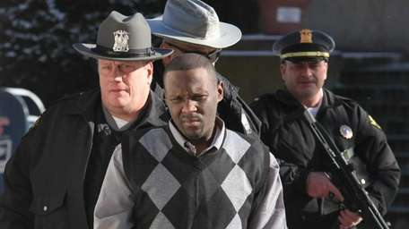 Accused cop killer Darrell Fuller arrives at the