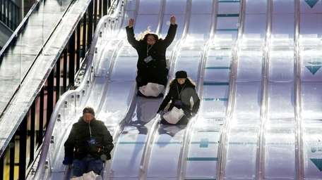 People fly down the Super Bowl toboggan run