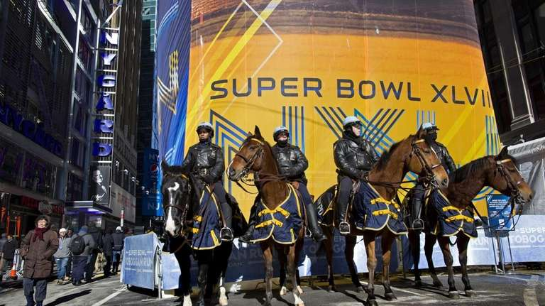 NYPD mounted officers stand guard along Super Bowl
