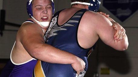 Port Jefferson's Kyle Fiske controls Mattituck's Stepehn Ostrowski