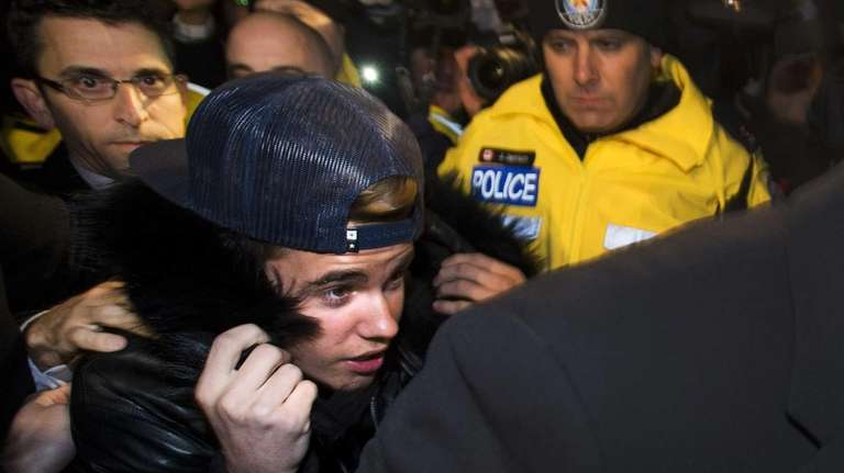 Canadian musician Justin Bieber is swarmed by media