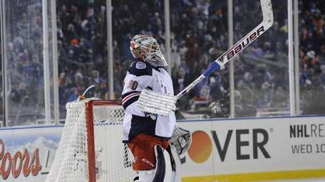 Rangers goalie Henrik Lundqvist reacts after the Islanders