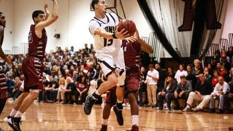 Molloy's John Petrucelli drives to the basket for