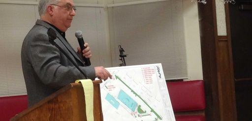 Architect Steven Cataldo presents plans for a drive-up