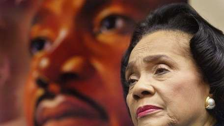 Coretta Scott King stands in front of a