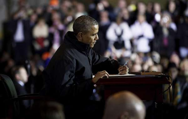 President Barack Obama signs an executive order to
