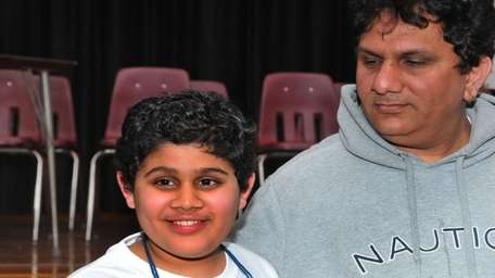 From left: Naman Shakrani, from W.T. Clarke Middle