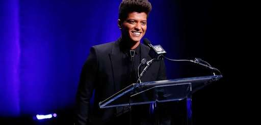 Singer Bruno Mars speaks during the Pepsi Super