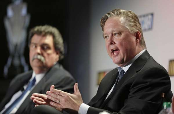 NASCAR CEO Brian France, right, answers a question