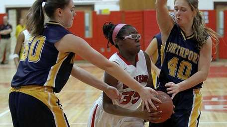 Half Hollow Hills East's Kristen McKenzie splits Northport's