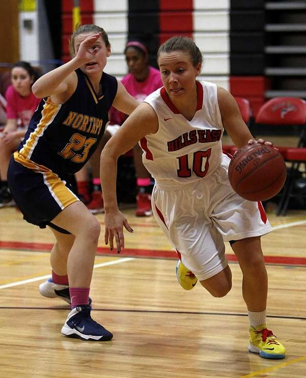 Hills East's Julia Gnieser drives the baseline around