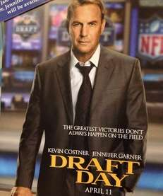 "A sign advertising the movie ""Draft Day"", starring"
