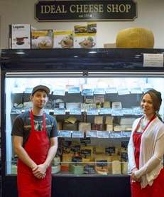 Cheesemongers Michael Roselle and Melissa Panarello stand in