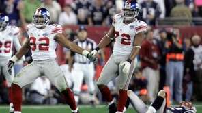 Giants' Michael Strahan, left, and Osi Umenyiora celebrate