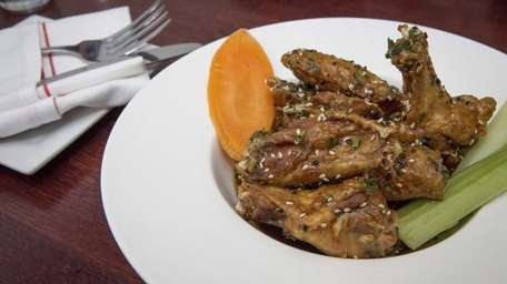 Chicken wings with a pomegranate teriyaki glaze are