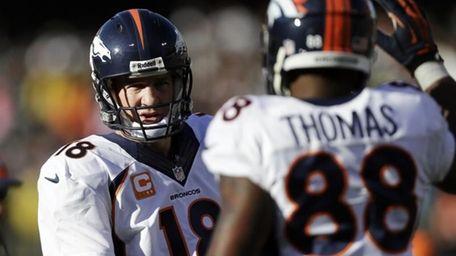 Denver Broncos quarterback Peyton Manning celebrates a touchdown