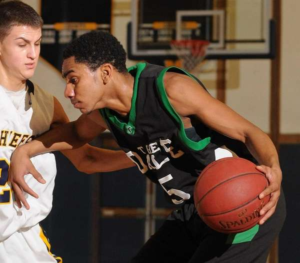 Farmingdale's Malik Seelal shields the ball from Massapequa's