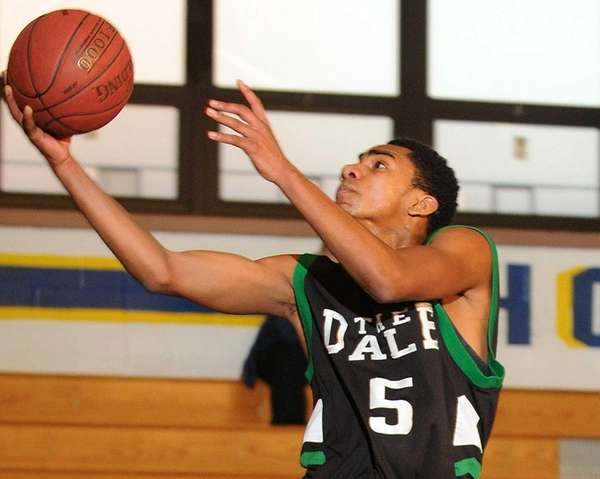 Farmingdale's Malik Seelal drives to the basket during