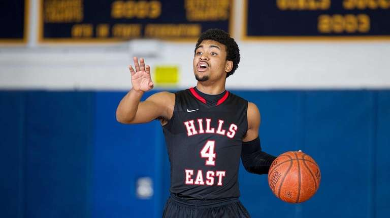 Half Hollow Hills East's Mike Simon carries the