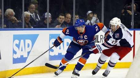 John Tavares, No. 91 of the Islanders, skates