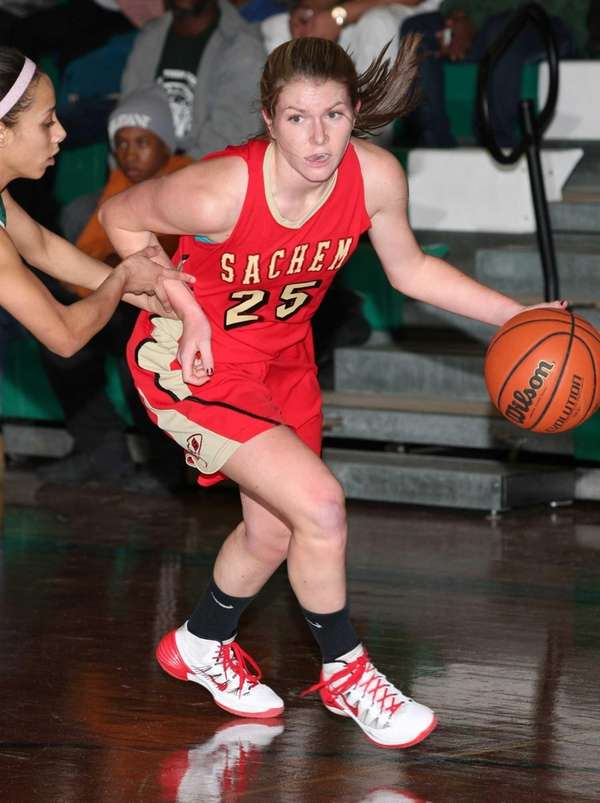 Sachem East 's Katie Doherty moves the ball
