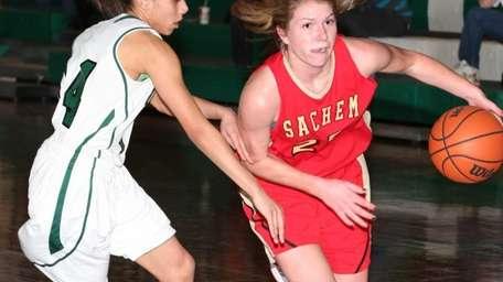 Sachem East's Katie Doherty gets by Brentwood's Natasha