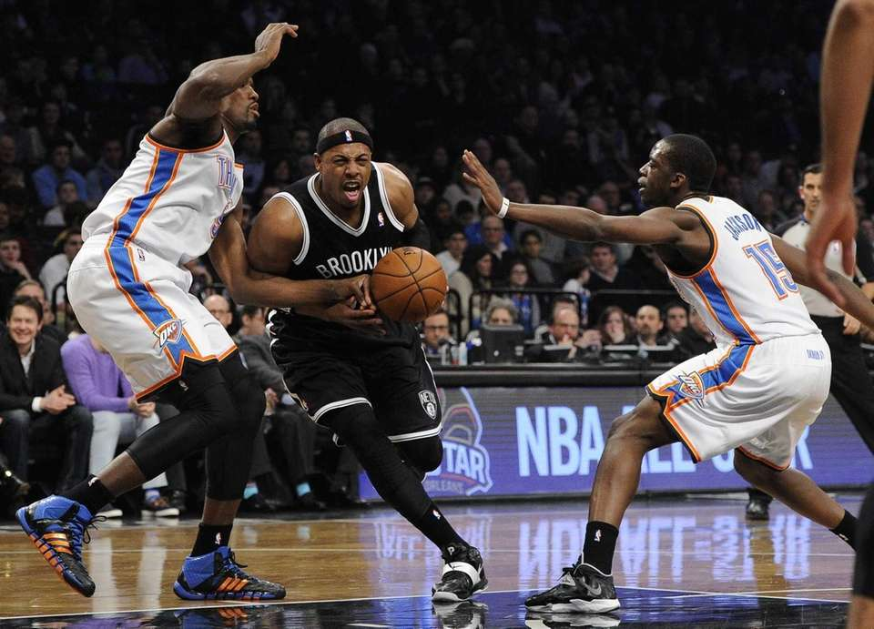 Nets forward Paul Pierce drives between Thunder forward