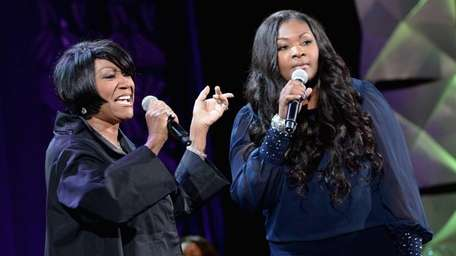 Patti LaBelle, left, and Candice Glover perform onstage