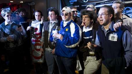 Patrons and participants sport Mike Francesa looks at