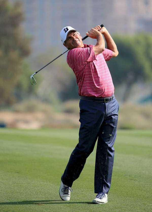 Fred Couples plays his second shot during the