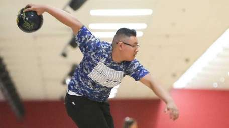 Division's Brandon Soedarmasto bowls during the Nassau County