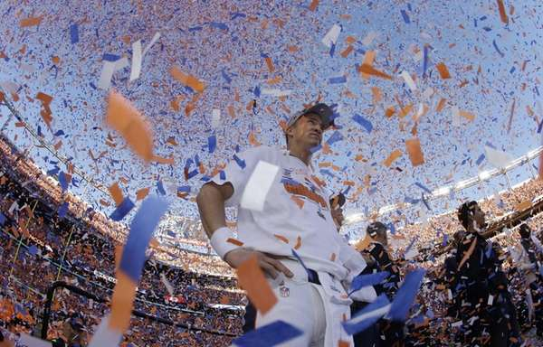 Broncos quarterback Peyton Manning is engulfed in confetti