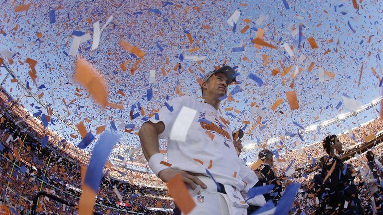 Broncos quarterback Peyton Manning is engulfed in confetti