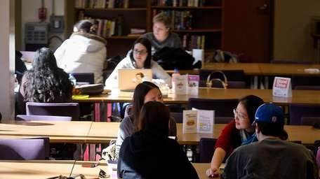 Students gather inside the Swirbul Library on the