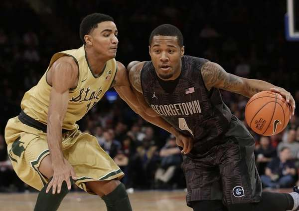 Michigan State's Gary Harris defends Georgetown's D'Vauntes Smith-Rivera