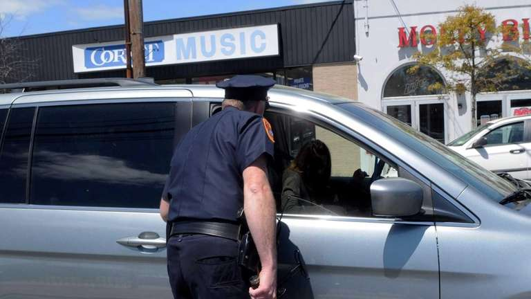A Suffolk County police officer checking radar on