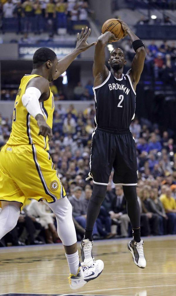 Kevin Garnett shoots over Pacers center Roy Hibbert