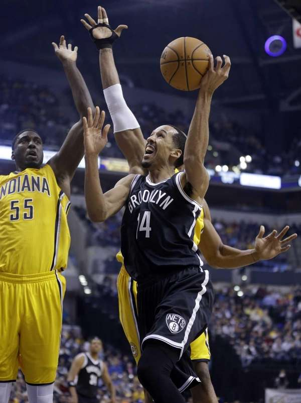 Nets guard Shaun Livingston is fouled as he