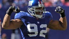 Giants defensive end Michael Strahan reacts after sacking