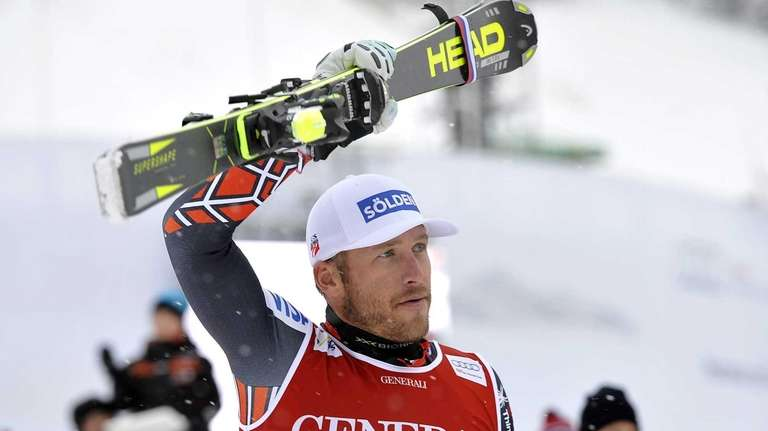 Bode Miller celebrates in the finish area after
