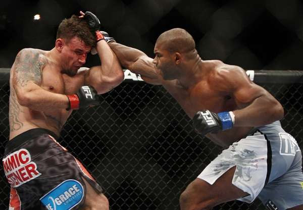 Frank Mir, left, and Alistair Overeem, of the