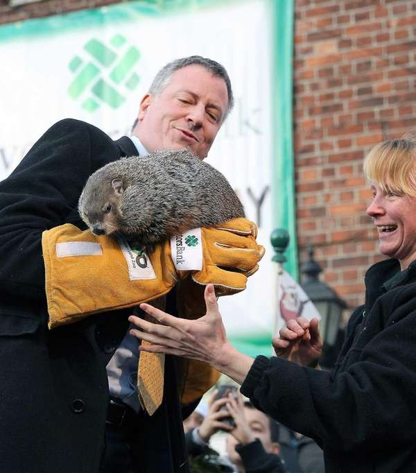 Mayor Bill de Blasio hangs on to a