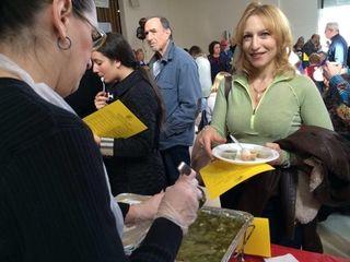 Edy Koehler, 48, of Port Washington, tries soups