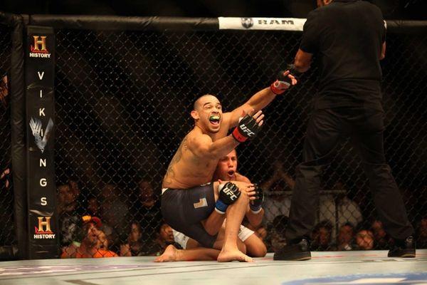 Renan Barao defeats Urijah Faber at UFC 169